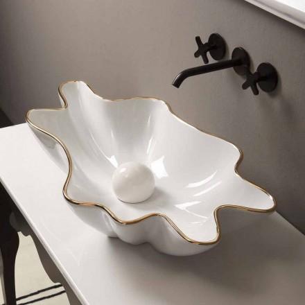 Umywalka nablatowa Rayan z białej ceramiki i złotej krawędzi, design