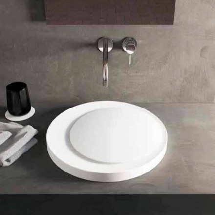 Zaprojektowana okrągła umywalka nablatowa w stałej powierzchni Luxolid Crema