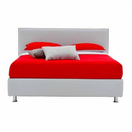 Podwójne łóżko pokryte sztuczną skórą z nóżkami Made in Italy - Nurzio